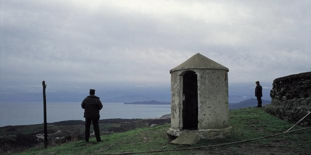 Civil_guards_watch_over_the_frontier_of_Ceuta_Two_civil_guards_next_to_a_hut_watch_over_the_coastal_frontier_of_Ceuta. (1)